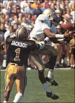 Split end Pat Terrell comes up with the pass as Purdue's Steve Jackson moves in to make the tackle in the 1987 game.