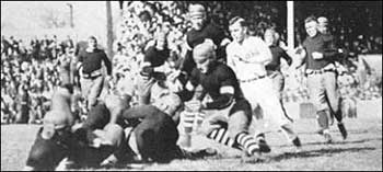 A scramble for the loose ball in the 1915 clash in Linclon.
