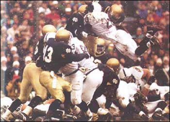 In a crucial defensive play in the fourth quarter, Demetrius DuBose and Devon McDonald stop Penn State at the goaline. (Courtesy of the University of Notre Dame Archives)