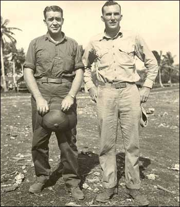 Navy Lt. Frank Leahy, left, meets his former star player Angelo Bertelli, a Marines 2nd Lieutenant on a Central Pacific Island in 1945. Leahy spent 1944 and 1945 in service before returning to Notre Dame as head coach in 1946.